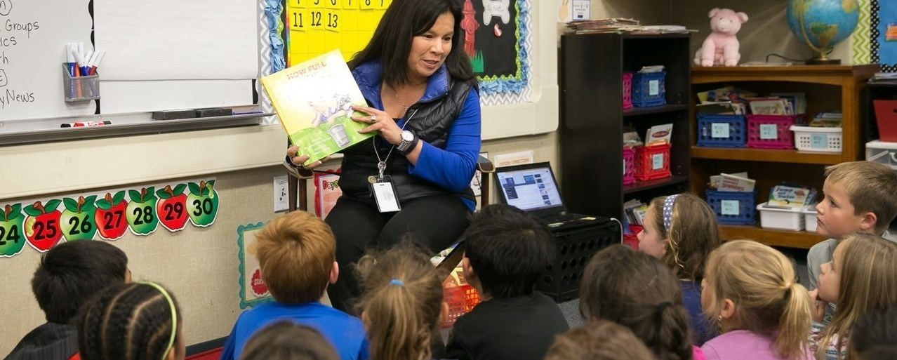 Liberty teacher reading to students
