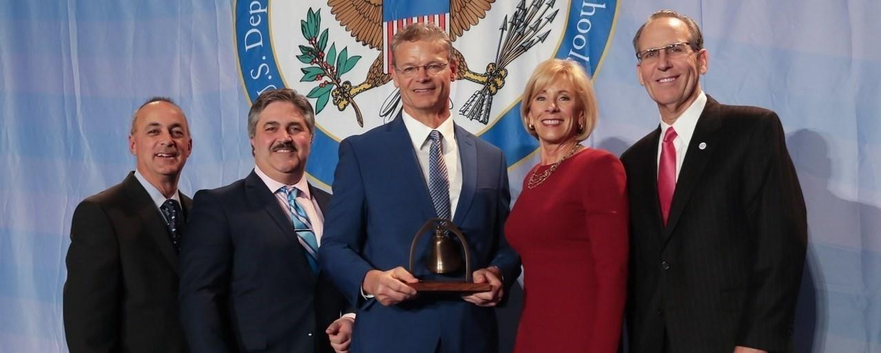 Mr. Petersen receiving the The Terrell Bell Award in Washington D.C.